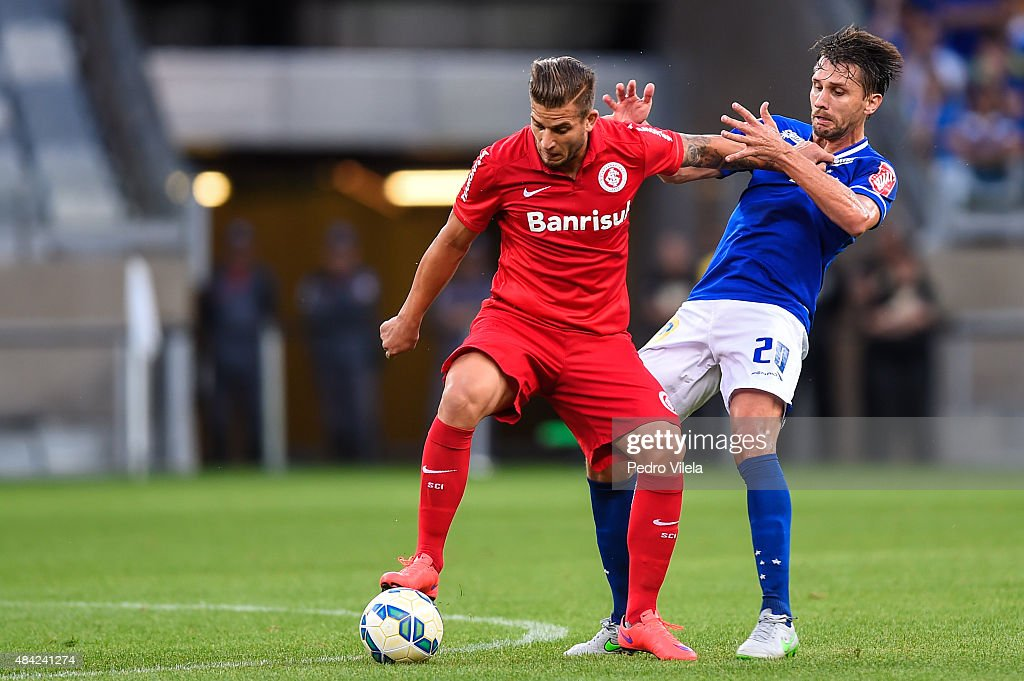 Paulo Andre #20 of Cruzeiro and Rafael Moura #11 of Internacional battle for the ball during a match between Cruzeiro and Internacional as part of Brasileirao Series A 2015 at Mineirao stadium on August 16, 2015 in Belo Horizonte, Brazil.