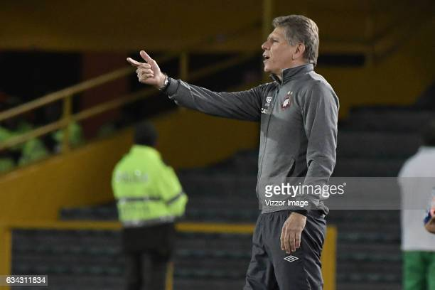 Paulo Autuori coach of Atletico Paranaense gives instructions to his players during a match between Millonarios and Atletico Paranaense as part of...
