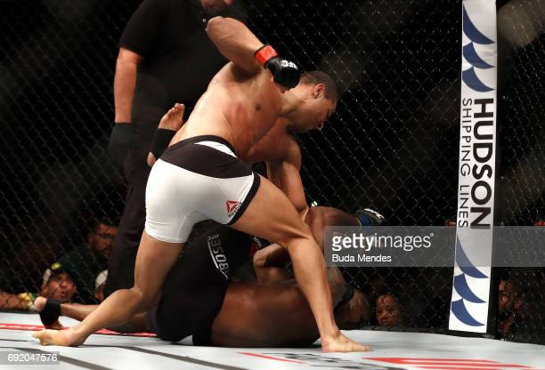 Paulo Borrachinha of Brazil punches Oluwale Bamgbose in their middleweight bout during the UFC 212 event at Jeunesse Arena on June 3 2017 in Rio de...