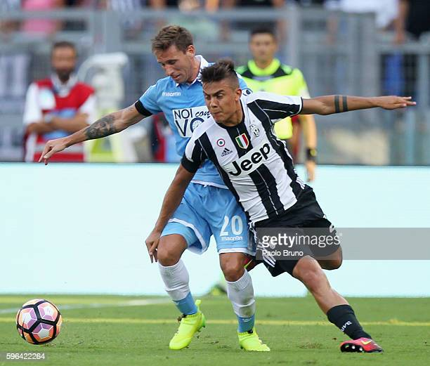 Paulo Bruno Exequiel Dybala of Juventus FC competes for the ball with Lucas Biglia of SS Lazio during the Serie A match between SS Lazio and Juventus...