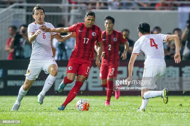 Paulo Carreiro of Hong Kong fights for the ball with Feng Xiaoting of China PR and Zou Zheng of China PR during their FIFA World Cup Qualifiers 2015...