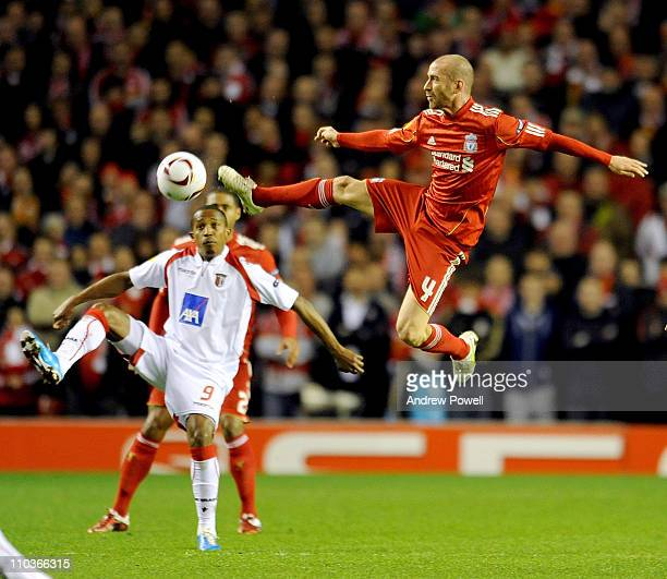 Paulo Cesar of Braga and Raul Meireles of Liverpool compete during the UEFA Europa League round of 16 second leg match between Liverpool and Braga at...
