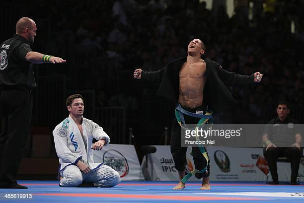 Paulo Costa of Brazil celebrates after winning against Vlacheslav Ilin of Russia in the Men's blue belt open weight finals during the Abu Dhabi World...