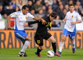 Paulo Da Silva of Real Zaragoza battles for the ball against Lionel Messi of FC Barcelona during the La Liga match between Real Zaragoza and FC...