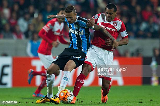 Paulo Da Silva of Toluca fights for the ball with Luan of Gremio during the group 6 match between Toluca and Gremio as part of Copa Libertadores 2016...