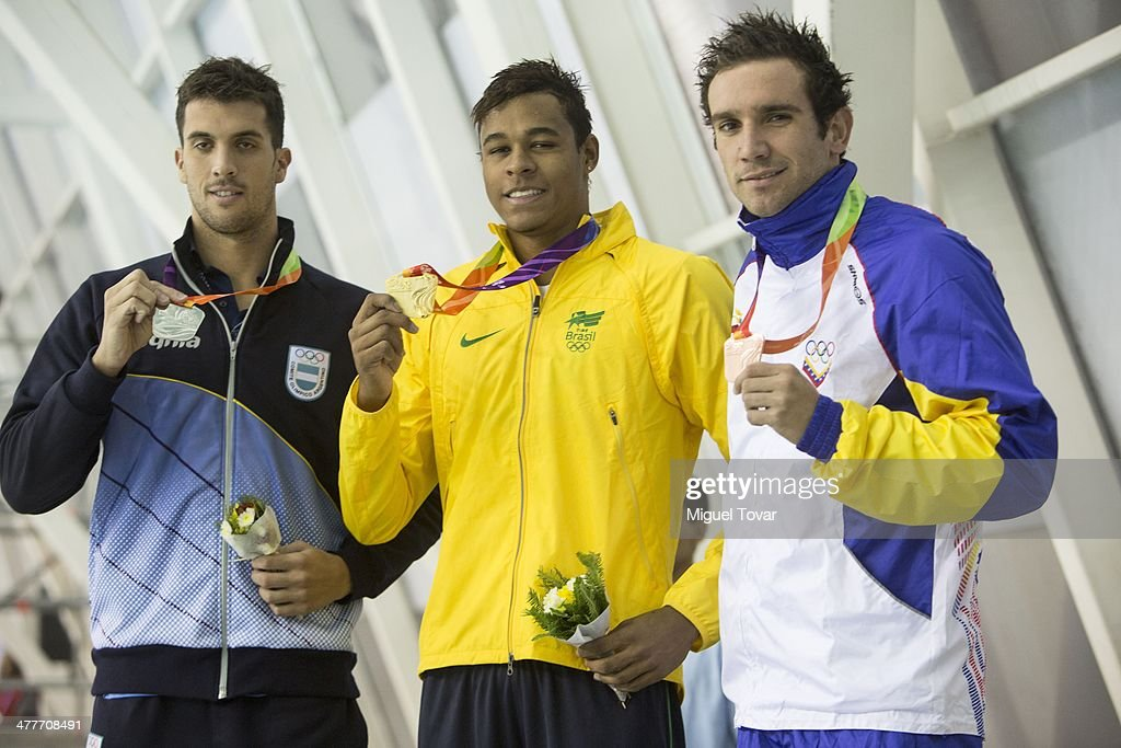 Paulo de Santana of Brazil shows his gold medal with Federico Grabich of Argentina and Alberto Subirats of Venezuela in mens 100m freestyle final event during day four of the X South American Games Santiago 2014 at Centro Acuatico Estadio Nacional on March 10, 2014 in Santiago, Chile.