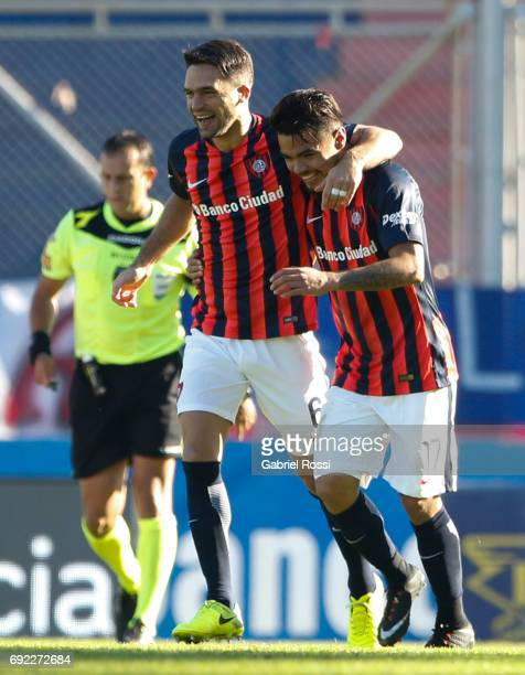 Paulo Diaz of San Lorenzo celebrates with teammate Matias Caruzzo after scoring the second goal of his team during a match between San Lorenzo and...