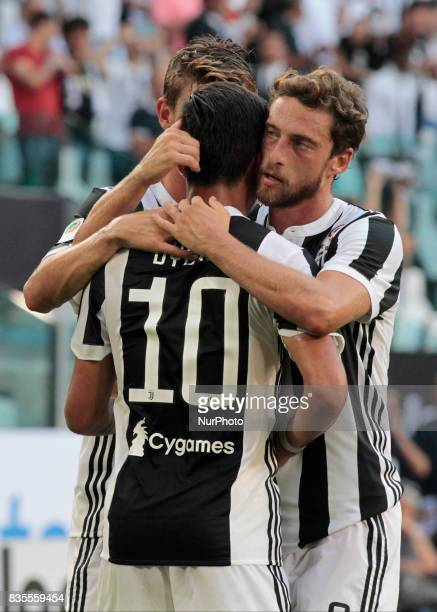 Paulo Dybala and Claudio Marchisio during Serie A match between Juventus v Cagliari in Turin on August 19 2017