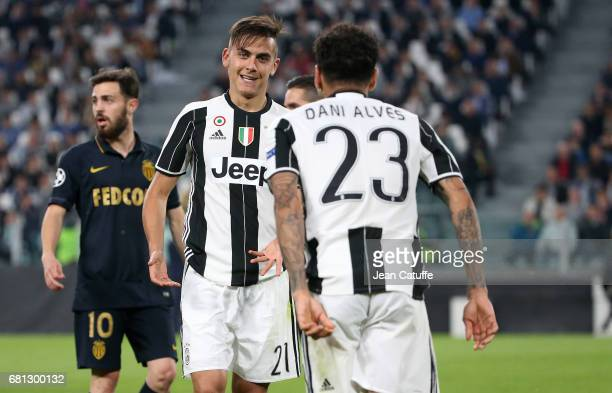 Paulo Dybala and Dani Alves of Juventus during the UEFA Champions League semi final second leg match between Juventus Turin and AS Monaco at Juventus...