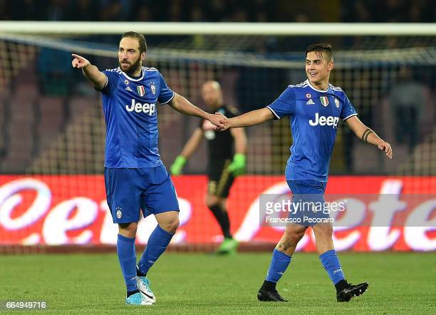 Paulo Dybala and Gonzalo Higuain of Juventus FC celebrate the 01 goal scored by Gonzalo Higuain during the TIM Cup match between SSC Napoli and...