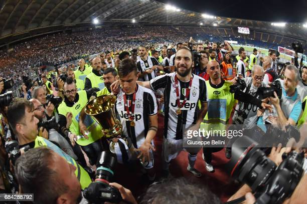 Paulo Dybala and Gonzalo Higuain of Juventus FC celebrate the victory after the TIM Cup Final match between SS Lazio and Juventus FC at Olimpico...