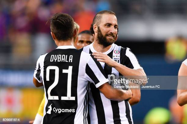 Paulo Dybala and Gonzalo Higuain of Juventus in action during the International Champions Cup match between Juventus and Barcelona at MetLife Stadium...