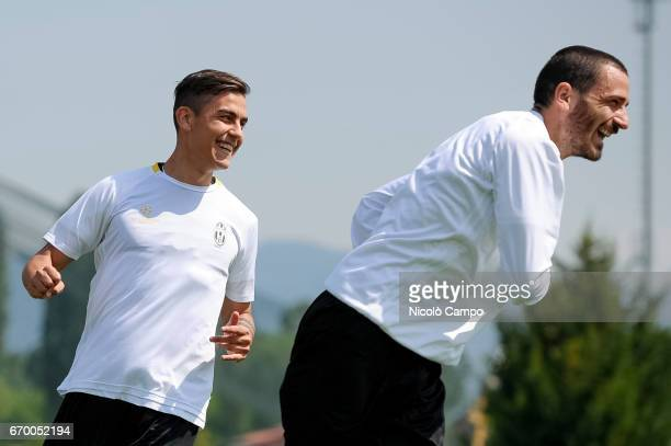 Paulo Dybala and Leonardo Bonucci of Juventus FC do an exercise during a training session on the eve of the UEFA Champions League football match...
