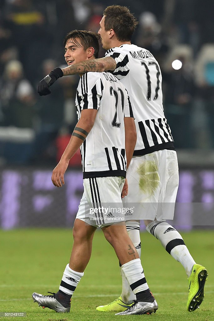 Paulo Dybala (L) and Mario Mandzukic of Juventus FC celebrate victory at the end of the Serie A match betweeen Juventus FC and ACF Fiorentina at Juventus Arena on December 13, 2015 in Turin, Italy.