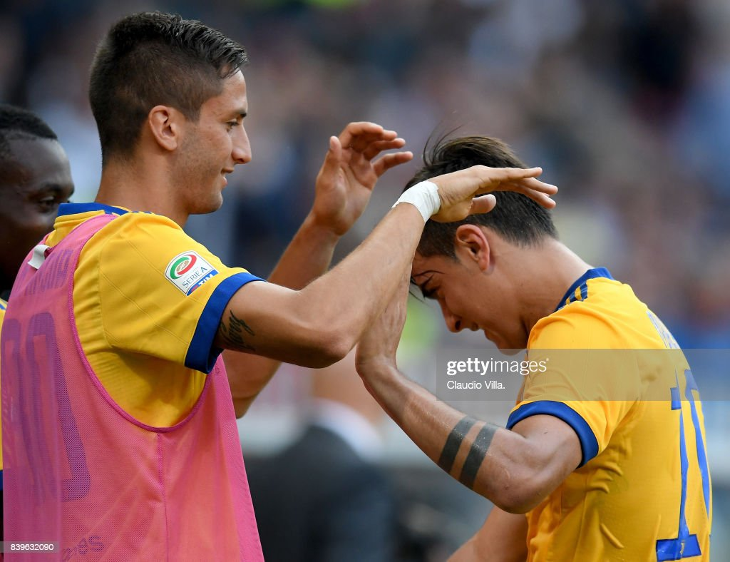 Paulo Dybala (R) and Rodrigo Bentancur Colmán of Juventus FC celebrate at the end of the Serie A match between Genoa CFC and Juventus at Stadio Luigi Ferraris on August 26, 2017 in Genoa, Italy.