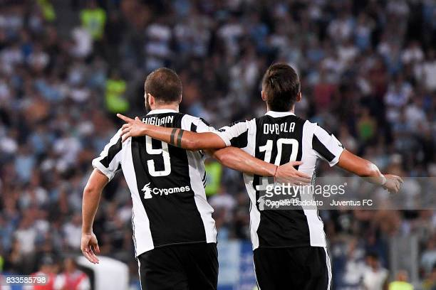 Paulo Dybala celebrates 22 goal with Gonzalo Higuain during the Italian Supercup match between Juventus and SS Lazio at Stadio Olimpico on August 13...