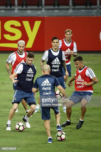 Paulo Dybala challenges Javier Pastore for the ball during an Argentina training session at National Stadium on June 12 2017 in Singapore Argentina...