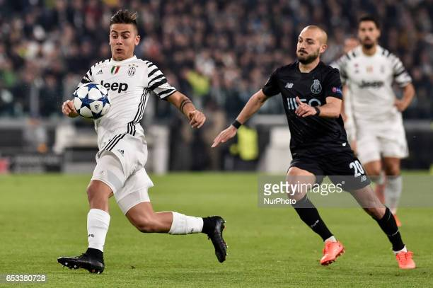 Paulo Dybala forward of Juventus FC is challenged by Porto's Portuguese midfielder Andre Andre during the UEFA Champions League Round of 16 2st leg...