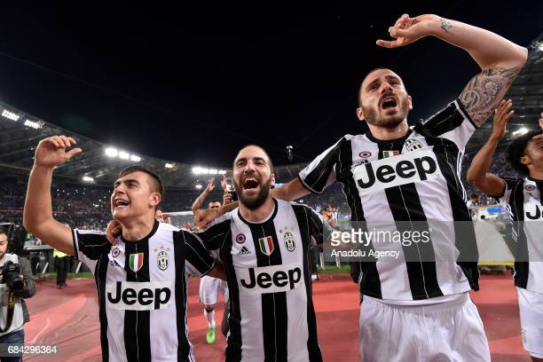 Paulo Dybala Gonzalo Higuain and Leonardo Bonucci of Juventus celebrate the victory after the TIM Cup final football match against SS Lazio at Stadio...
