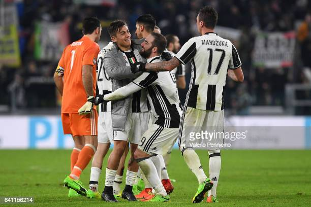 Paulo Dybala Gonzalo Higuain and Mario Mandzukic of Juventus FC celebrate victory at the end of the Serie A match between Juventus FC and FC...