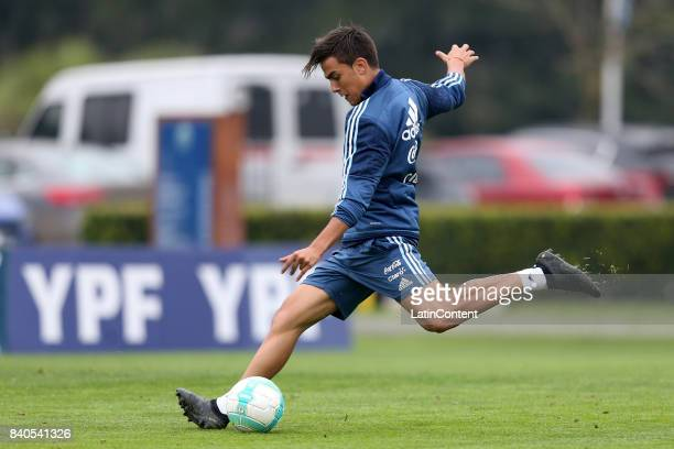 Paulo Dybala kicks the ball during a training session at 'Julio Humberto Grondona' training camp on August 29 2017 in Ezeiza Argentina