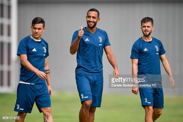 Paulo Dybala Medhi Benatia and Miralem Pjanic of Juventus during a training session on August 9 2017 in Vinovo Italy