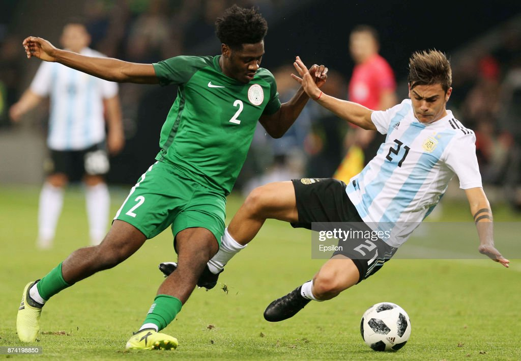 Paulo Dybala of Argentina fights for the ball with Ola Aina of Nigeria during an international friendly match between Argentina and Nigeria at Krasnodar Stadium on November 14, 2017 in Krasnodar, Russia.