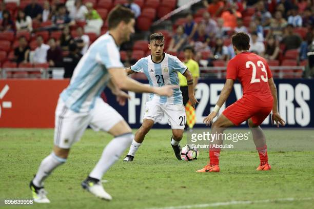 Paulo Dybala of Argentina looks to pass during the International Test match between Argentina and Singapore at National Stadium on June 13 2017 in...