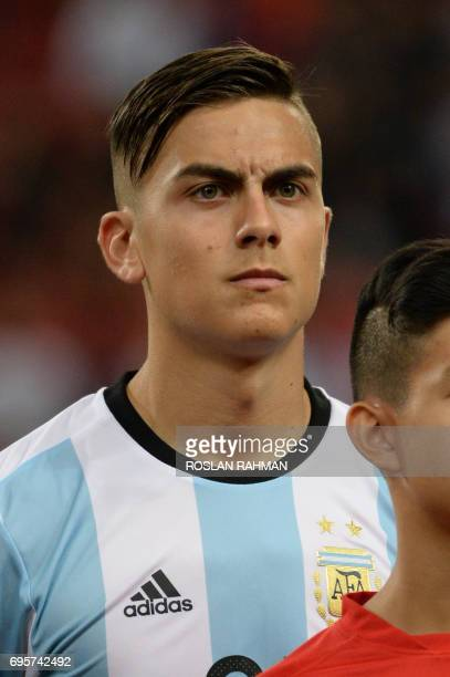 Paulo Dybala of Argentina poses before the start of their international friendly football match against Singapore at the National Stadium in...