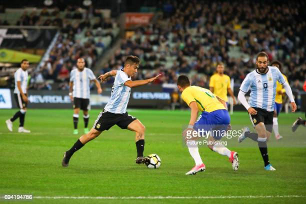 Paulo Dybala of Argentina running with the ball as Brazil plays Argentina in the Chevrolet Brasil Global Tour on June 9 2017 in Melbourne Australia...
