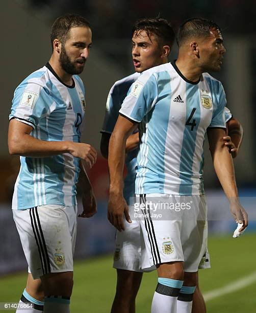 Paulo Dybala of Argentina talks to teammate Gonzalo Higuain during a match between Argentina and Paraguay as part of FIFA 2018 World Cup Qualifiers...