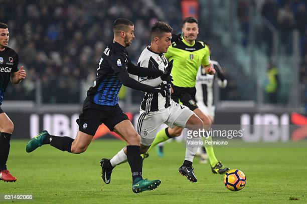 Paulo Dybala of FC Juventus competes with Leonardo Spinazzola of Atalanta BC during the TIM Cup match between FC Juventus and Atalanta BC at Juventus...