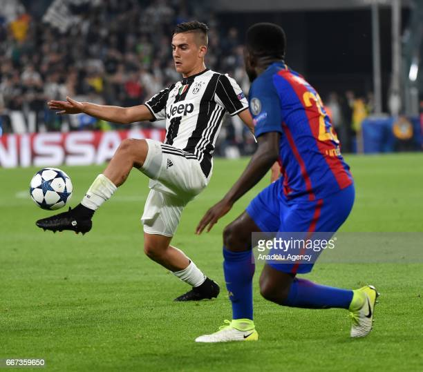 Paulo Dybala of FC Juventus in action against Samuel Umtiti of FC Barcelona during the UEFA Champions League Round of 4 first leg match between FC...