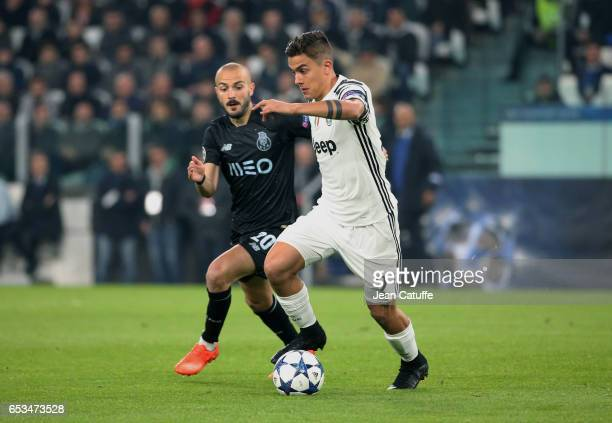 Paulo Dybala of Juventus and Andre Andre of FC Porto during the UEFA Champions League Round of 16 second leg match between Juventus Turin and FC...