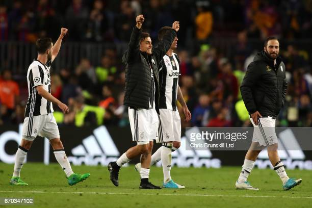 Paulo Dybala of Juventus and his teammates celebrate at the end of the UEFA Champions League Quarter Final second leg match between FC Barcelona and...