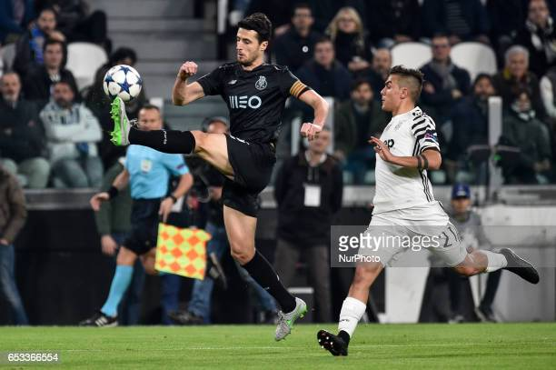 Paulo Dybala of Juventus and Iván Marcanoduring the UEFA Champions League Round of 16 game 2 match between Juventus and Porto at the Juventus Stadium...