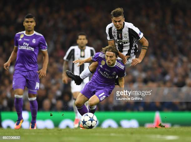 Paulo Dybala of Juventus and Luka Modric of Real Madrid battle for possession during the UEFA Champions League Final between Juventus and Real Madrid...