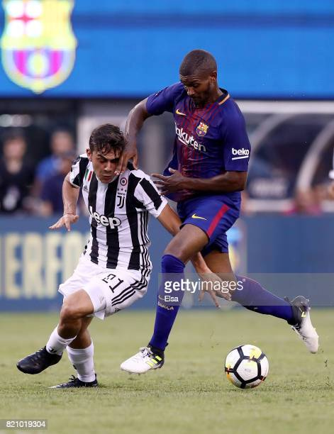 Paulo Dybala of Juventus and Marlon Santos of Barcelona fight for the ball during the International Champions Cup 2017 on July 22 2017 at MetLife...