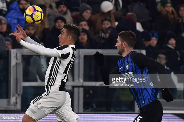 Paulo Dybala of Juventus and Roberto Gagliardini of Internazionale compete for the ball during the Serie A match between Juventus and FC...