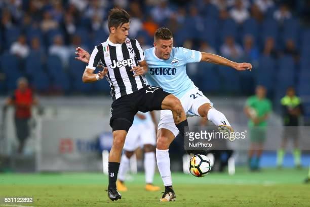 Paulo Dybala of Juventus and Sergej MilinkovicSavic of Lazio during the Italian Supercup match between Juventus and SS Lazio at Stadio Olimpico on...