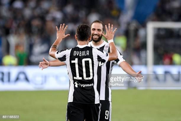 Paulo Dybala of Juventus celebrates scoring second goal with Gonzalo Higuain of Juventus during the Italian Supercup Final match between Juventus and...