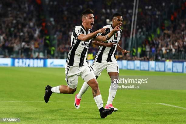 Paulo Dybala of Juventus celebrates scoring the second goal to make the score 20 with Alex Sandro during the UEFA Champions League Quarter Final...