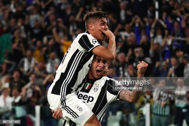 Paulo Dybala of Juventus celebrates scoring the second goal to make the score 20 with Mario Mandzukic during the UEFA Champions League Quarter Final...