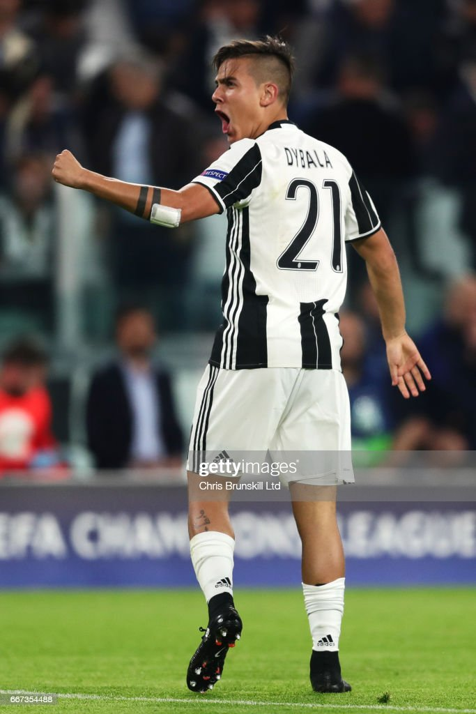 Paulo Dybala of Juventus celebrates scoring the second goal to make the score 2-0 during the UEFA Champions League Quarter Final first leg match between Juventus and FC Barcelona at Juventus Stadium on April 11, 2017 in Turin, Italy.