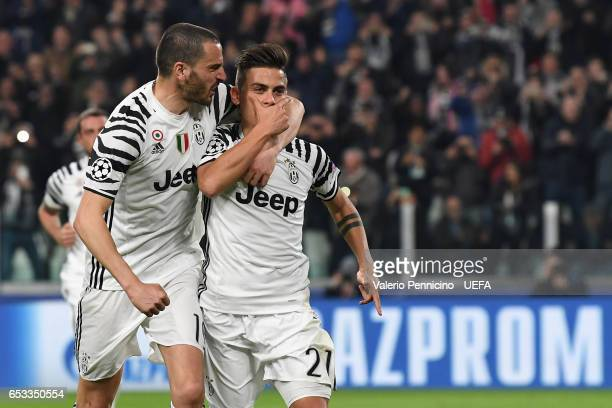 Paulo Dybala of Juventus celebrates the opening goal with team mate Leonardo Bonucci during the UEFA Champions League Round of 16 second leg match...