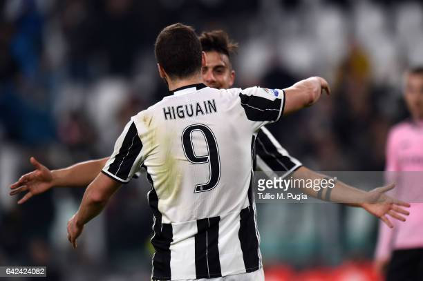 Paulo Dybala of Juventus celebrates with Gonzalo Higuain after scoring his team's fourth goal during the Serie A match between Juventus FC and US...