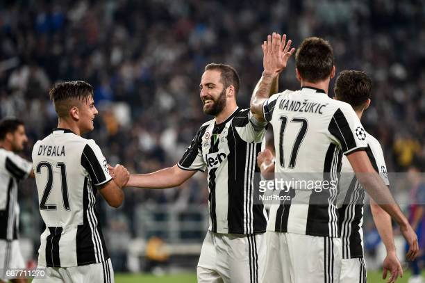 Paulo Dybala of Juventus celebrates with Gonzalo Higuain of Juventus scoring second goal during the UEFA Champions League quarter final match between...