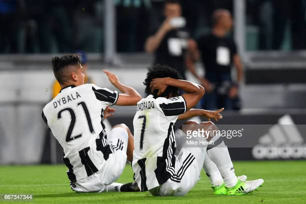 Paulo Dybala of Juventus celebrates with Juan Cuadrado after scoring the opening goal during the UEFA Champions League Quarter Final first leg match...