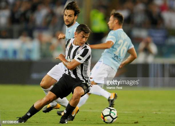 Paulo Dybala of Juventus compete for the ball with Marco Parolo of SS Lazio during the Italian Supercup match between Juventus and SS Lazio at Stadio...