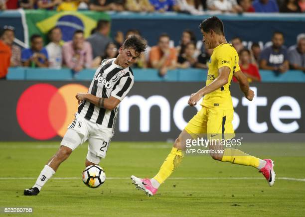 Paulo Dybala of Juventus dribbles the ball before Yuri Berchiche of Paris SaintGermain during their International Champions Cup friendly match at...
